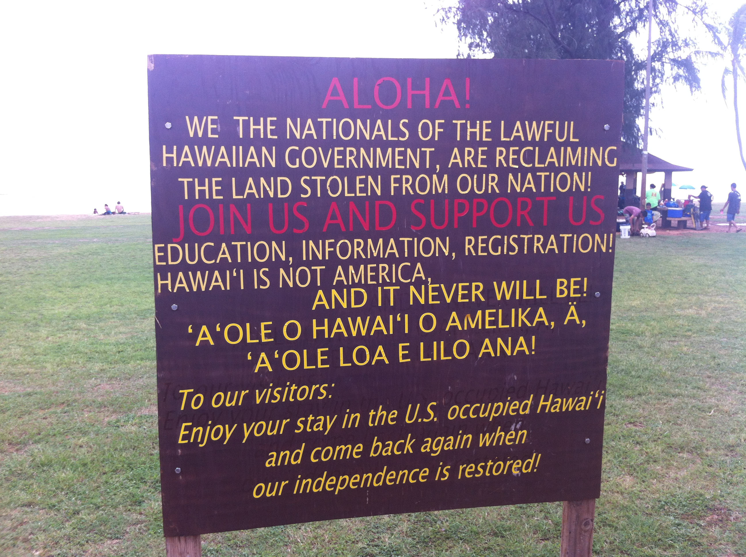 Signs for independence at Salt Pond Beach Park in Kauai.