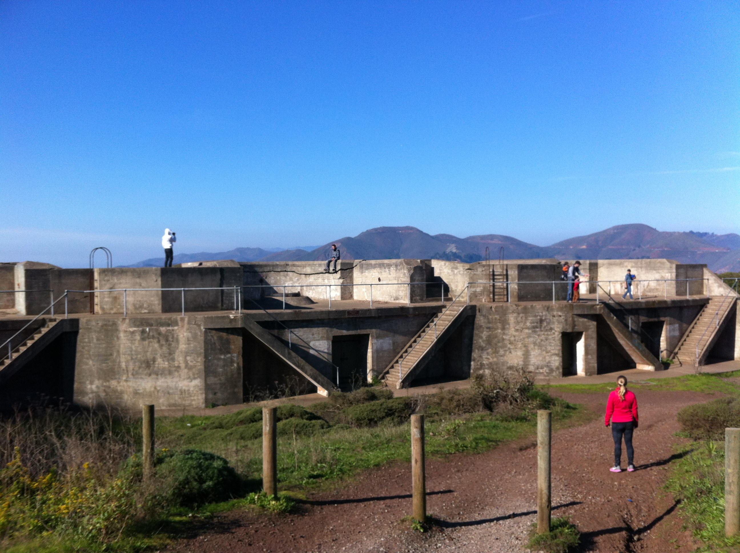 Steph checks out the numerous batteries along the Coastal Trail Battery Path.